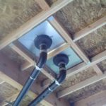 Roof drain installation showing the bottom view of the superior grade LCP double roof drain sump pan