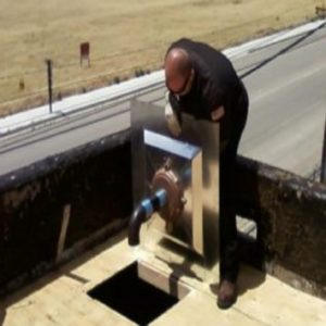 "Flat Roof Drain Installation. Plumber sumping a 15"" flat roof drain using model LSP roof drain sump pan standard version"