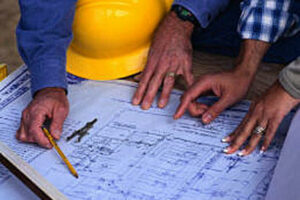 contractor reading blueprints