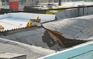 A flat roof that caved in from the weight of the standing rainwater.
